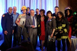 Don James, Chairman & Chief Executive Officer, Deeley Harley-Davidson® Canada, celebrates the support of local Vancouver Firefighters who donated an evening in-home dinner to the live auction.